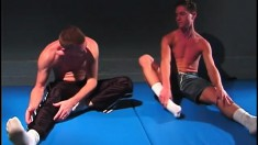 Jujitsu hunks warm up on the mat then work out their stiff man muscles